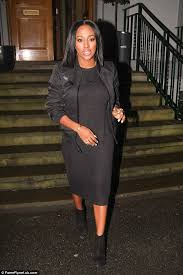 alexandra burke wears a black midi dress under a bomber jacket