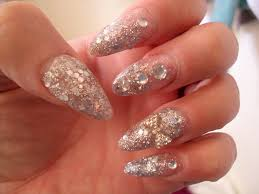 silver glitter with diamond bow and rhinestones acrylic almond