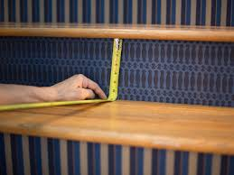 How To Cut Stair Runners by How To Step Up Your Stair Risers With Wallpaper Hgtv