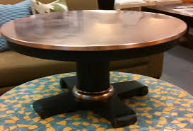 copper top oval coffee table the room looks classic with using