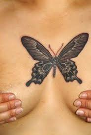 a butterfly tattoo designs between the is a symbol of a