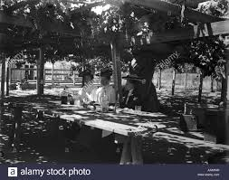 1890s 1900s three women seated at table under grape arbor trellis