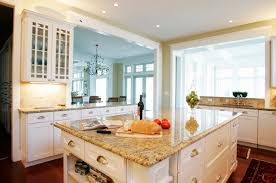 giallo fiorito granite with oak cabinets giallo ornamental granite countertops add elegance in the kitchen