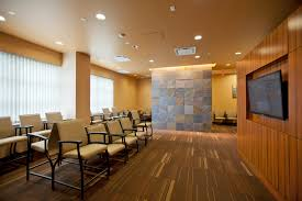 create a patient friendly waiting room with tv lift solutions
