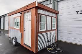 this 98 sq ft trailer looks tiny but hidden inside is a big surprise