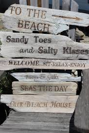 beachy signs need one that includes a sign pointing to the mountains as well