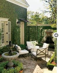 courtyard designs and outdoor living spaces decorating wrought iron and bench