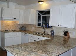 granite countertop chrome cabinets stone tile backsplash kitchen