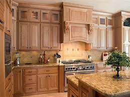 upper cabinets with glass doors cherry cabinets with natural finish view 2 two tiered island