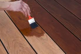 applying stain to your deck paint gurus