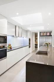 bright and modern kitchen with white cabinets and marble details