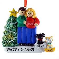 expecting couple with dog u0026 cat ornament dad brown hair mom blonde