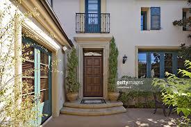 entrance to a beautiful mediterranean home exterior stock photo
