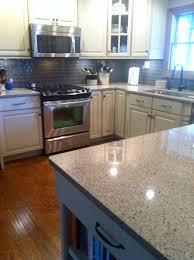 cabinets vanilla paint charcoal glaze viatera quartz countertop