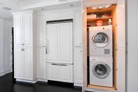 stunning white kitchen design with hidden laundry room and black