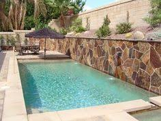 how to build a pool what to do with a sloped backyardspp inground