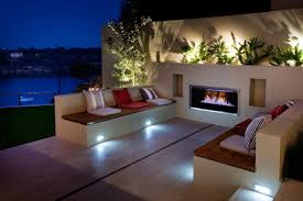 eye catching modern outdoor fireplaces turn the patio into a