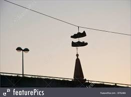 shoes hanging on wire stock picture i3752483 at featurepics silhouette of shoes hanging on the cable over the city