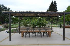 just completed woven willow canopy with steel frame pergola