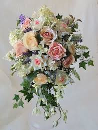 cascade bouquet pink blush and lavender roses lilacs and sprays cascading bouquet