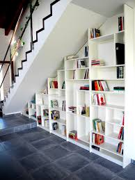 interior unique flooating wooden staircase with wall bookshelf