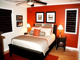 accents in design bedroom with burnt orange accent wall orange