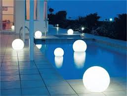 these moonlight globe lights can be placed in a pool hung from a
