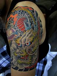dragon tattoo on left shoulder for men by chris garver