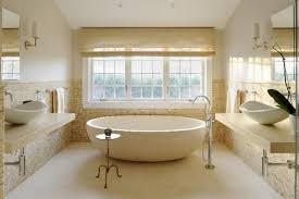 brown and beige bathroom tiles white soaking bathtubs shower with