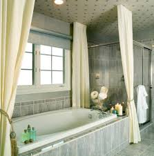 cool bathroom design idea using marble bathtub and divine cream