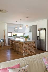 ppolished concrete island benchtop exposed brick and window