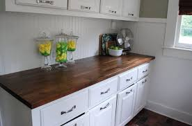 kitchen kitchen island with stove and butcher block countertop