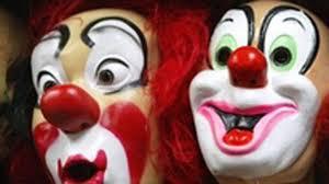 steven tyler halloween mask men dressed as clown in halloween mask wave knives at girls