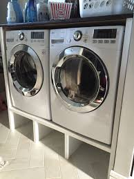 contemporary washer and dryer pedestal cabinet with cubbies below