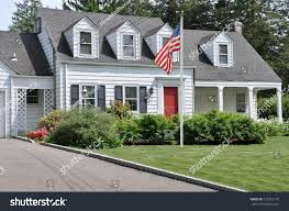 Cape Cod Style Home by American Flag Pole On Front Yard Stock Photo 216212176 Shutterstock