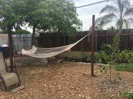 a relaxing backyard hangout in san diego complete with a hammock