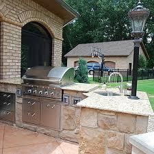 umbrella stand in outdoor kitchen outdoors kitchens island