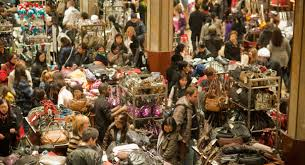 hordes of shoppers inside macy s in new york looking for bargains