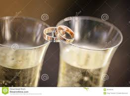glass wedding rings wedding rings lie on chagne glasses stock photo image 48763045