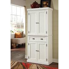 standing white wooden pantry cabinet with two layer storage having