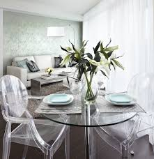 contemporary condo dining room with glass dining table ghost