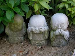 three monkeys around and about with