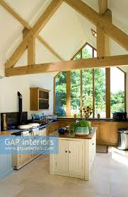 gap interiors kitchen with island exposed roof beams limestone