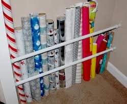 Organize Gift Wrap - 25 crazy clever uses for cheap tension rods one good thing by jillee