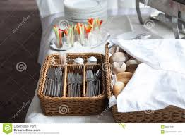 catering a bread basket with cutlery and snacks for cocktail
