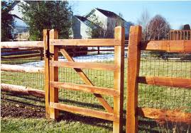 wooden slat fence with metal posts for support rail fence