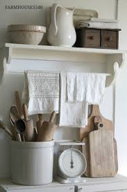 farmhouse kitchen white painted furniture and neutral wood tones farmhouse kitchen white painted furniture and neutral wood tones a collection of vintage ironstone