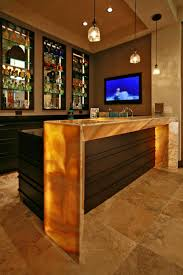 a lighted waterfall countertop frames the outer edge of the bar