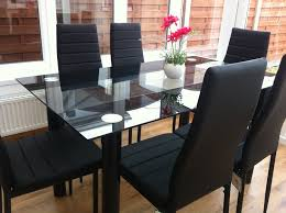 STUNNING GLASS BLACK DINING TABLE SET AND  FAUX LEATHER CHAIRS - Black and white dining table with chairs