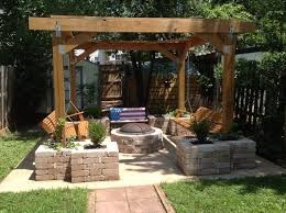 pit stop husband built this pergola with planters and fire pit on